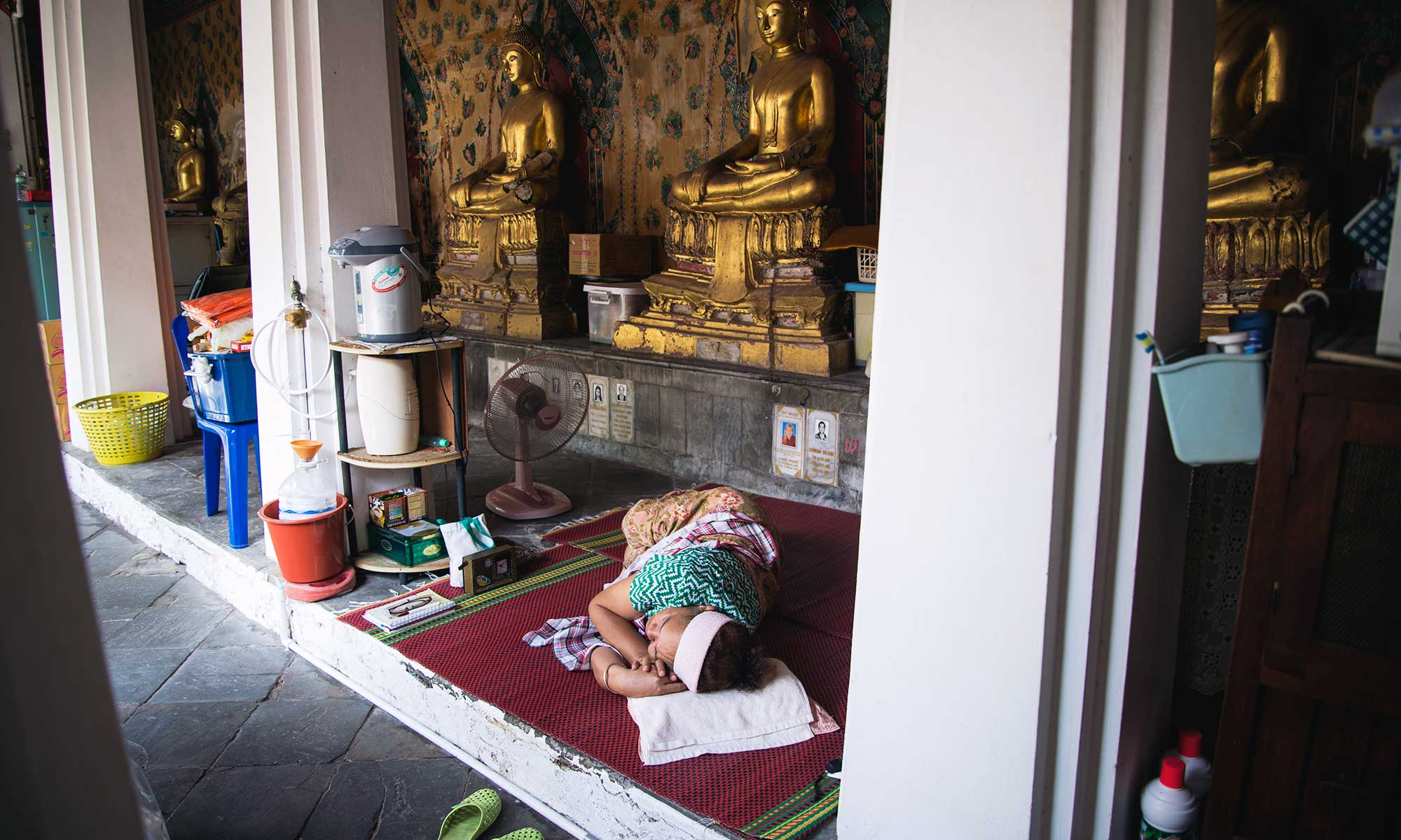 woman sleeping inside temple