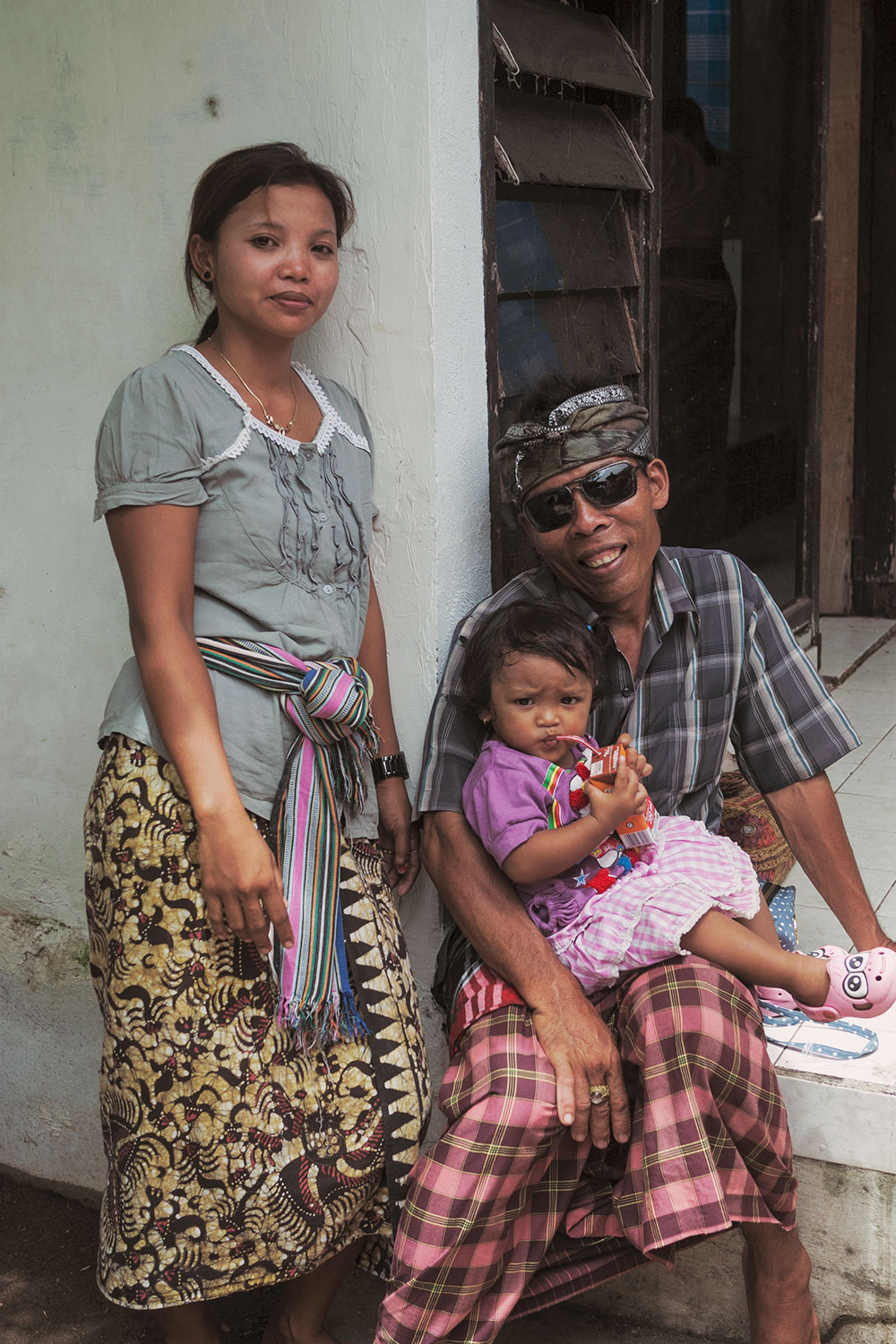 Komang, Wayan, and their little girl