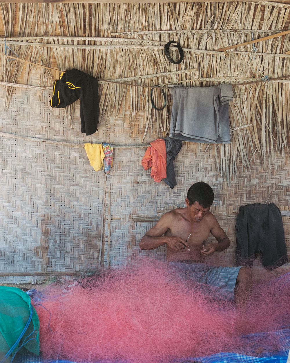 man preparing nets