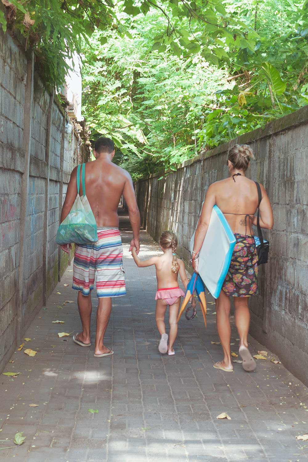 family in beach wear