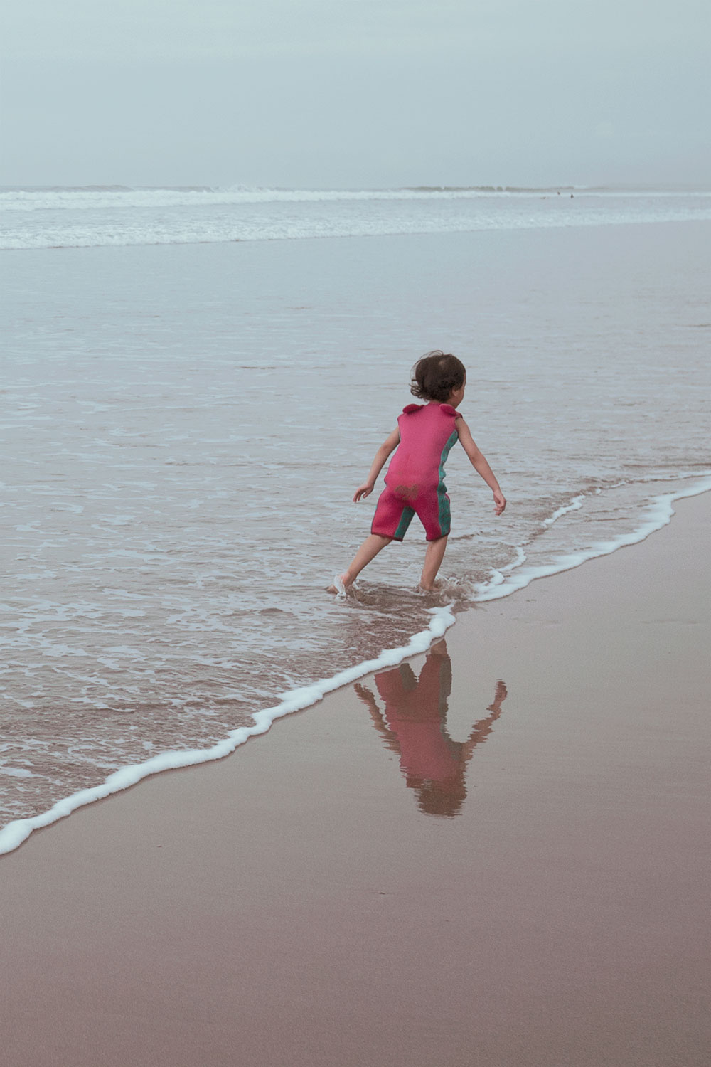 child playing in beach