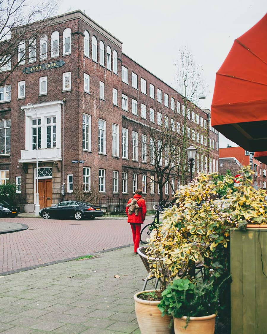 Woman with a red bag in Amsterdam