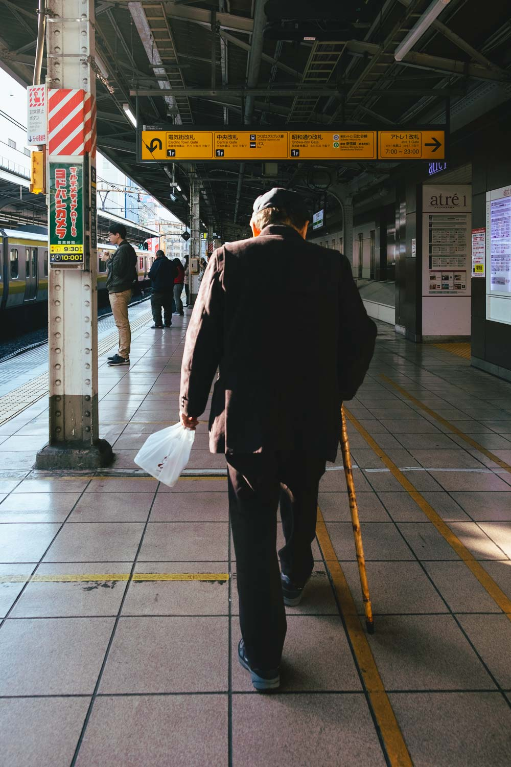 man walking in train station